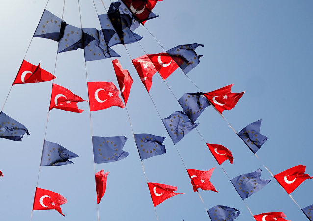 Turkish and European Union flags fly together at Taksim Square on May 24, 2013, in Istanbul.