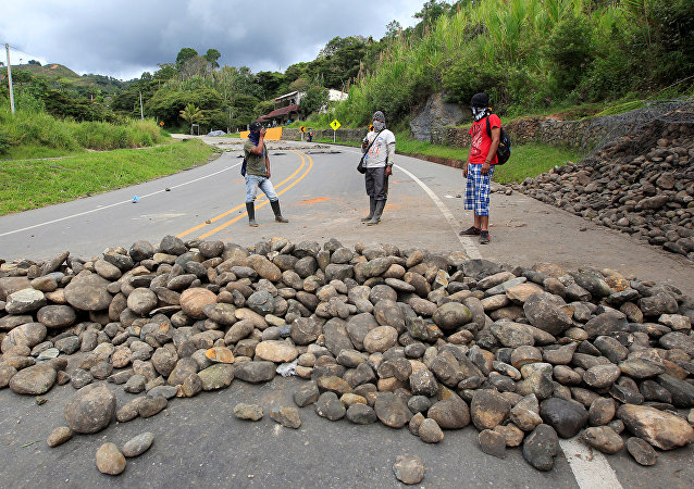 Indigenous people protest against the goverment, demanding land reform and increased state spending in rural areas, at the Panamerican highway in Mondomo, Cauca, Colombia, June 3, 2016.