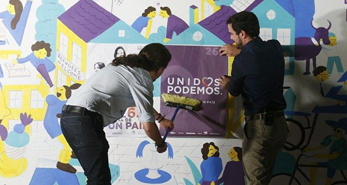 Secretario general de Podemos, Pablo Iglesias, y líder de Izquierda Unida, Alberto Garzon