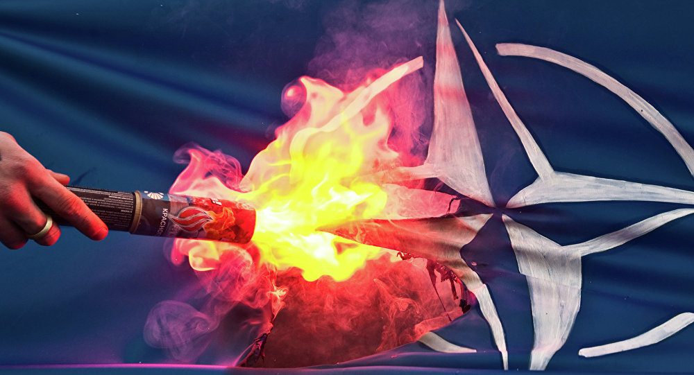 NATO flag set on fire by protesters