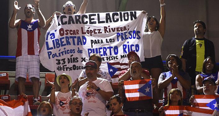 Aficionados al baloncesto puertoriqueños están exigiendo la excarcelación de Oscar López Rivera