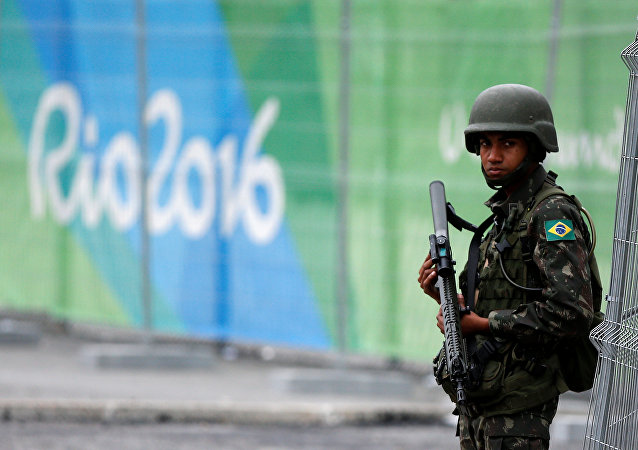 A soldier of the Brazilian Armed Forces stands guard outside the 2016 Rio Olympics Park in Rio de Janeiro, Brazil, July 21, 2016.