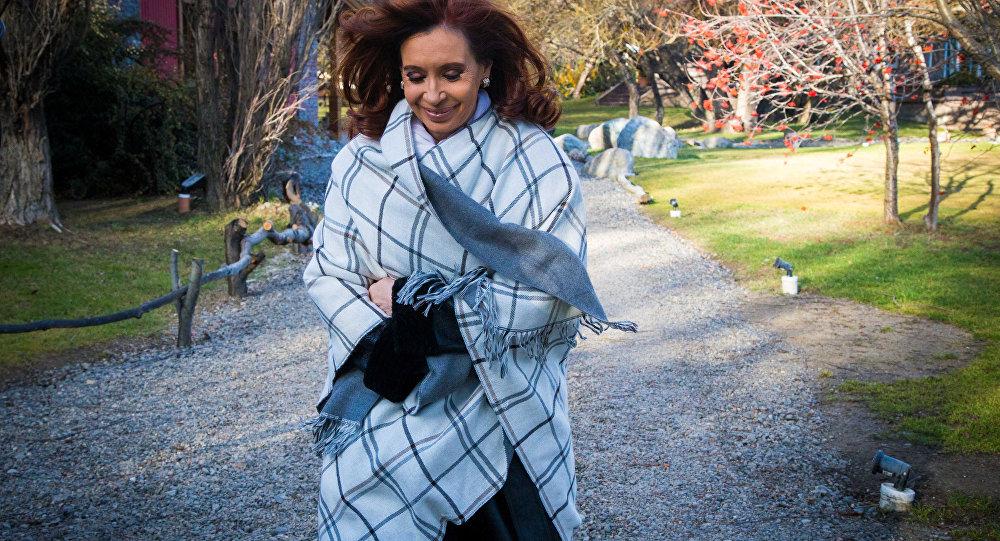 Former Argentine President Cristina Fernandez de Kirchner strolls by the garden of her residence in the Patagonian city of El Calafate, Santa Cruz province, Argentina, July 21, 2016.