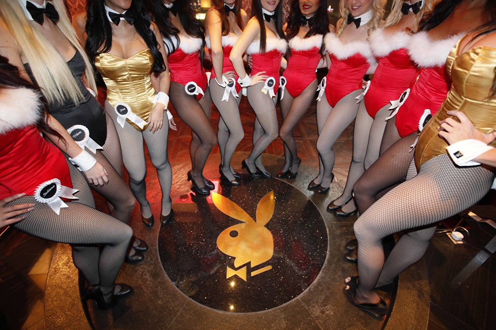 In this photo taken Saturday, Dec. 18, 2010, waitresses pose inside the Playboy Club at the Sands Casino in Macau. February marks the start of the year of the rabbit in the Chinese lunar calendar
