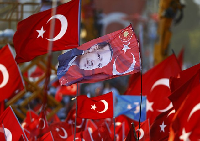A flag with the picture of Turkey's President Tayyip Erdogan is seen during the Democracy and Martyrs Rally