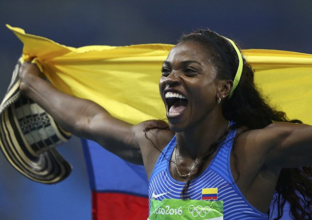 Caterine Ibargüen, atleta colombiana, medallista de oro olímpico