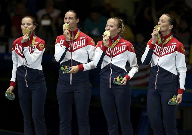 Deportistas rusas con medallas de oro