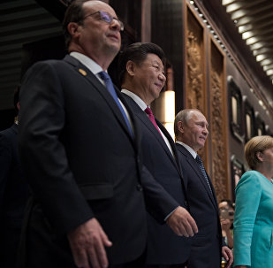 Presidentes Francois Hollande, Xi Jinping, Vladimir Putin y la cancillera alemana Angela Merkel