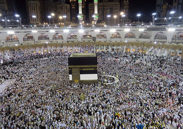 Muslim pilgrims circle the Kaaba at the Grand Mosque in Mecca