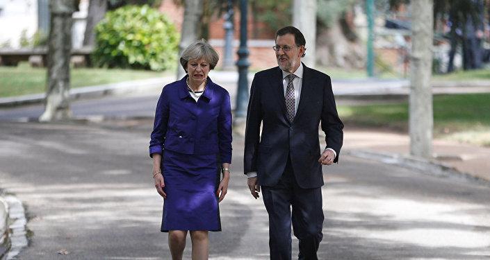 Theresa May, primera ministra del Reino Unido, y Mariano Rajoy, presidente en funciones de España