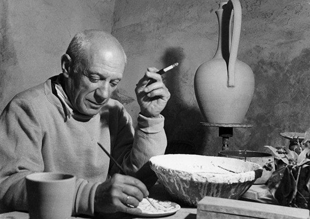 Pablo Picasso applies himself to a project of ceramics in his workshop in Vallauris April 1949