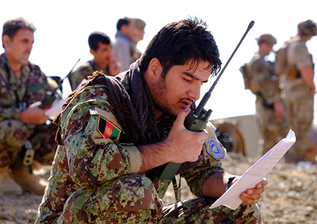 An Afghan Tactical Air Controller practices directing an air strike during an exercise at a range outside Kabul