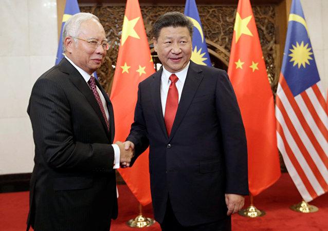 El primer ministro de Malasia, Najib Razak, y el presidente de China, Xi Jinping