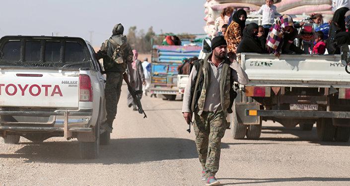 Los miembros de las SDF en Al Raqa