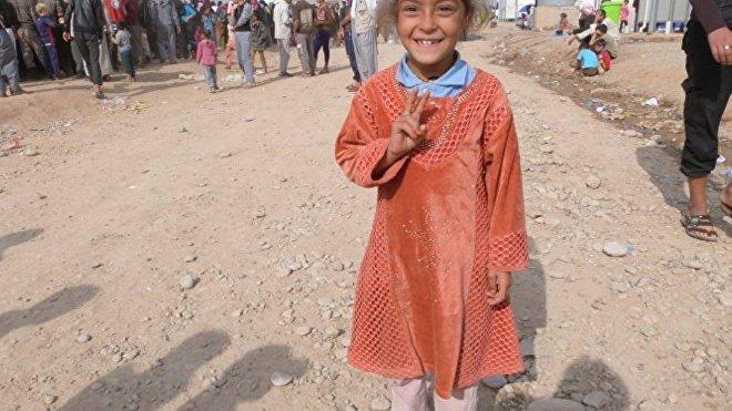 Una niña iraquí en el campo de refufiados de Hazir