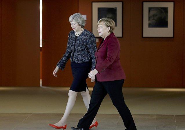 La canciller de Alemania, Angela Merkel y la primera ministra del Reino Unido, Theresa May
