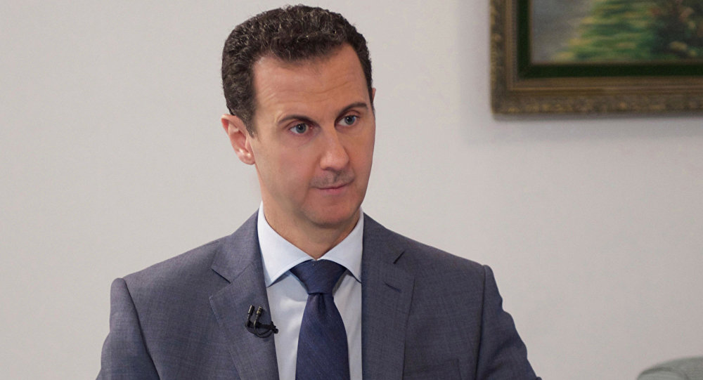 Syria's President Bashar al-Assad speaks during an interview with al-Watan newspaper in Damascus, Syria, in this handout picture provided by SANA on December 8, 2016.