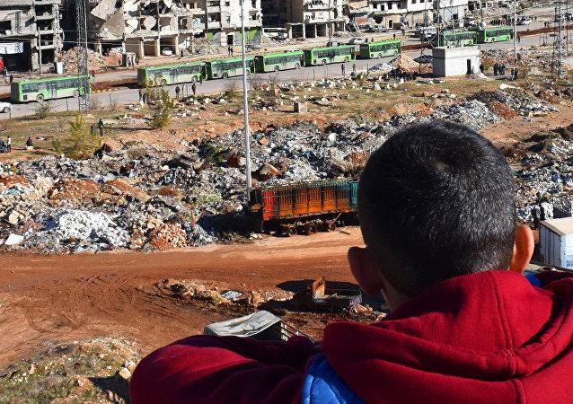 La operación para la retirada de los combatientes y sus familias de Alepo