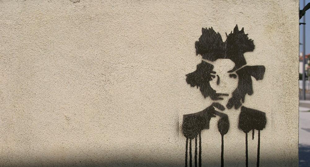 Un grafiti con el retrato de Basquiat