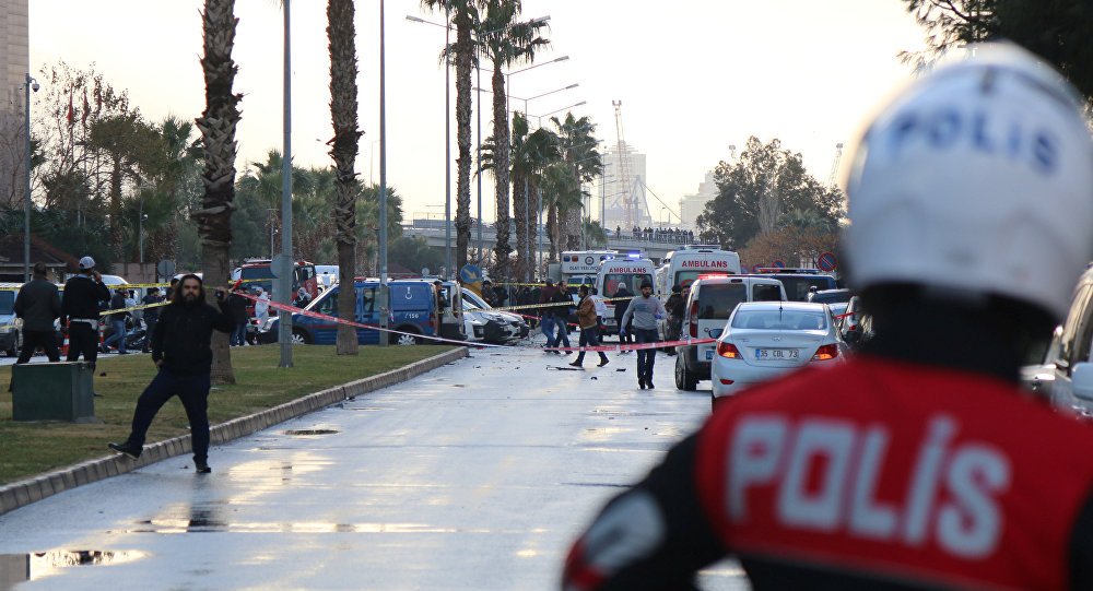 Police secure the area after an explosion outside a courthouse in Izmir, Turkey