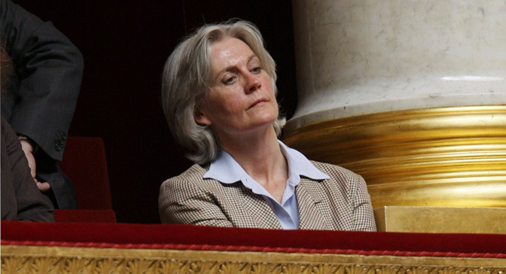 Penelope Fillon, France's Prime Minister Francois Fillon's wife, listens as her husband delivers a speech in front of the newly elected National Assembly