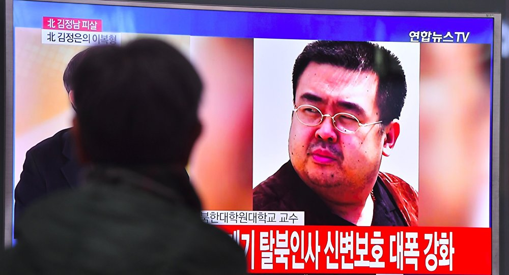 A man watches a television showing news reports of Kim Jong-Nam, the half-brother of North Korean leader Kim Jong-Un, in Seoul on February 14, 2017