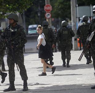 Brazilian Army soldiers patrol Brazil Avenue in Rio de Janeiro,