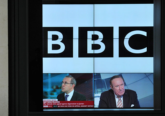 A BBC logo is pictured on a television screen inside the BBC's New Broadcasting House office in central London, on November 12, 2012