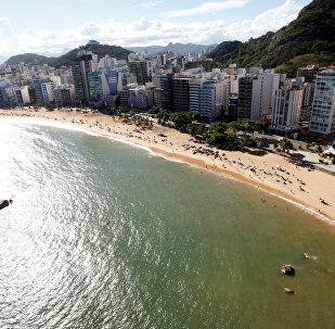 People enjoy the sea at Costa beach during a summer day in Vila Velha, Espirito Santo, Brazil,