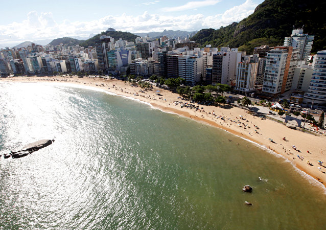 People enjoy the sea at Costa beach during a summer day in Vila Velha, Espirito Santo, Brazil,