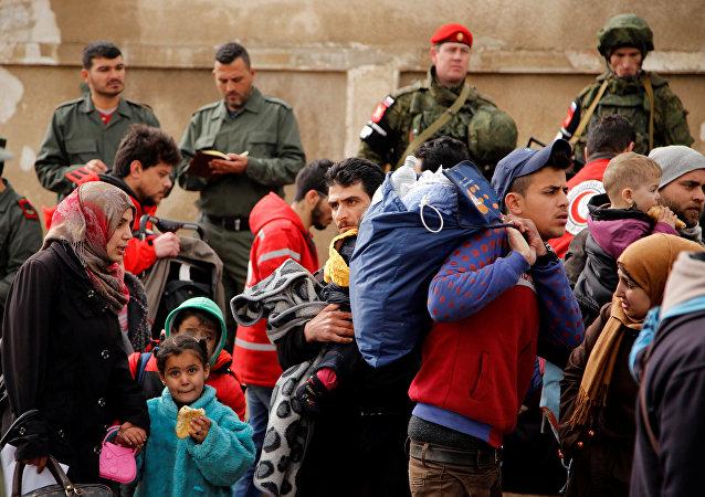Habitantes de Homs y soldados rusos e iraqíes