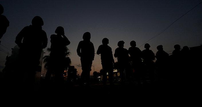 Policías durante los disturbios en la cárcel en Cadereyta