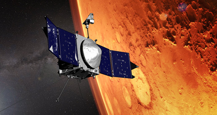 Una representación artística de la sonda espacial MAVEN sobrevolando Marte