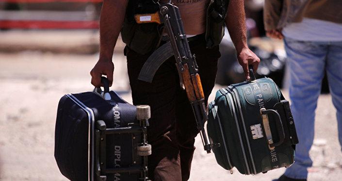 Los radicales y sus familiares abandonan Homs, Siria