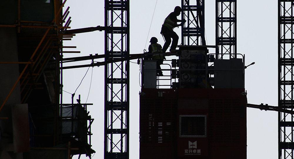 Obreros chinos