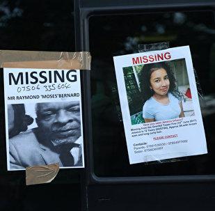 Fotos de desaparecidos en incendio en Londres