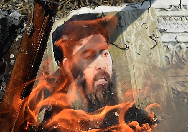 Foto de Abu Bakr Bagdadi en llamas