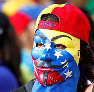Participante de una manifestación en Venezuela