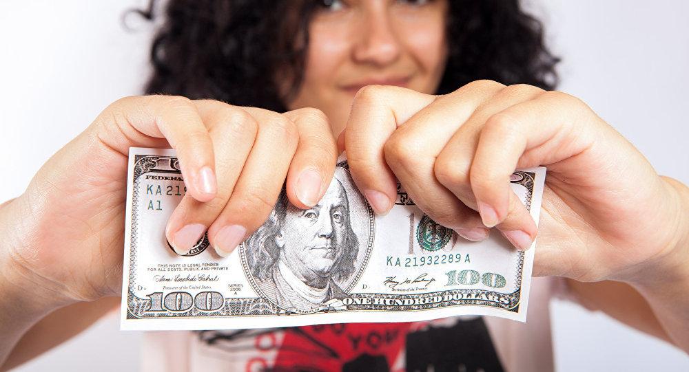 Rompiendo un dólar