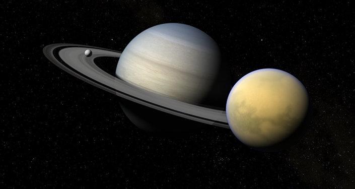 Saturno y sus satélites Titán y Encélado