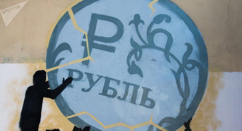Un grafiti del rublo ruso