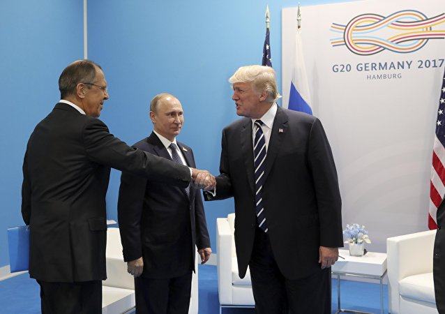 El canciller ruso, Serguéi Lavrov, el presidente ruso, Vladímir Putin, y el presidente de EEUU, Donald Trump (archivo)