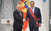 El presidente de Rusia, Vladímir Putin, y el ministro de Exteriores, Sergéi Lavrov