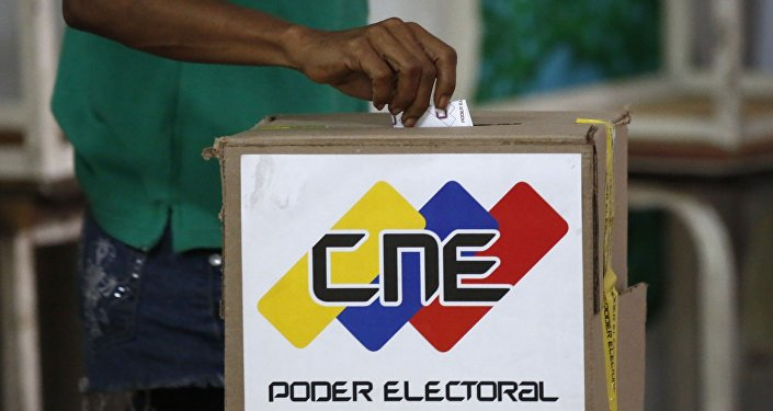 A voter casts a ballot during the Constituent Assembly election in Caracas, Venezuela