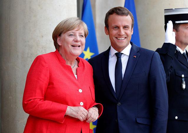 La canciller alemana, Angela Merkel, el presidente de Francia, Emmanuel Macron