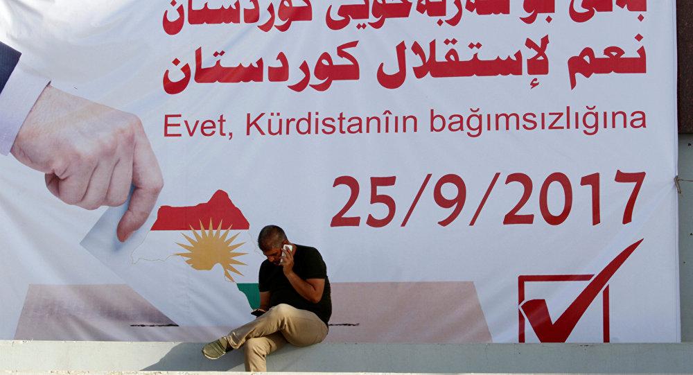Un cartel con la fecha del refernéndum independista de los kurdos iraquíes