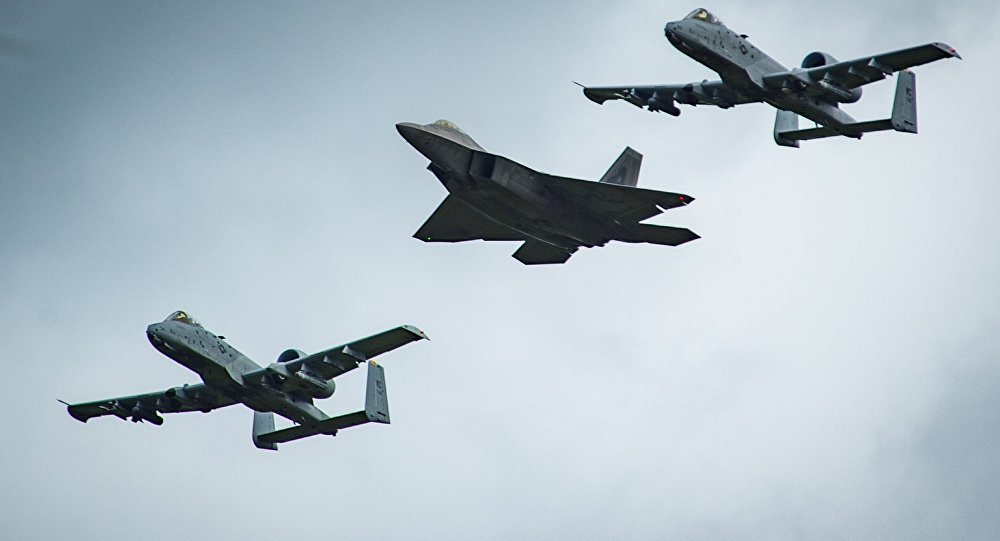 An F-22 Raptor and two A-10 Thunderbolt