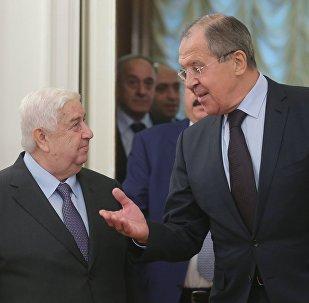 Ministro de Exteriores de Siria, Walid Mualem y canciller de Rusia, Serguéi Lavrov
