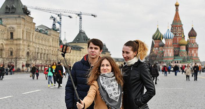 Los turistas en la Plaza Roja, Moscú