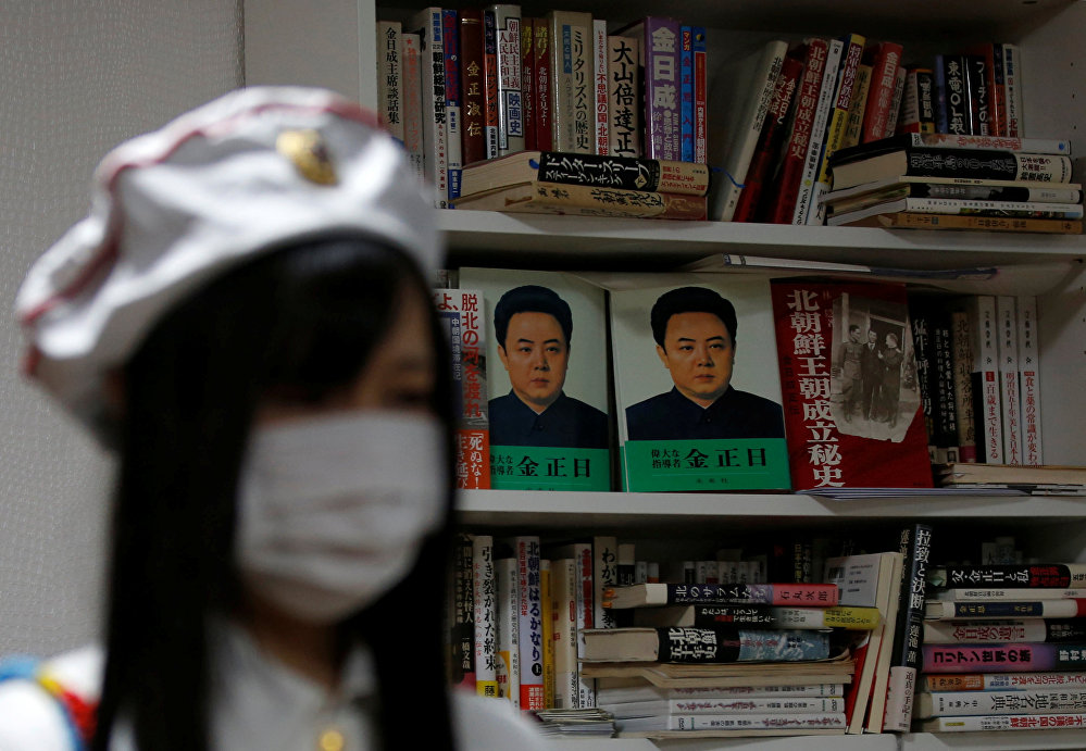 A member of Japan's North Korea fan club called sengun-joshi, or military-first girls, is seen in front of books of North Korea during their Moranbong Band dance practice in Tokyo, Japan October 22, 2017